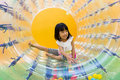 Happy Asian Chinese Little Girl Playing Roller Wheel Royalty Free Stock Photo