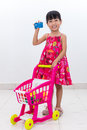 Happy Asian Chinese little girl pushing trolley holding credit c Royalty Free Stock Photo