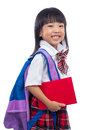Happy Asian Chinese little girl with school bag and book
