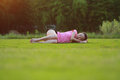 Happy Asian Chinese woman relax on grass Royalty Free Stock Photo