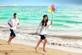 Happy asian couple honeymoon at beach focus on female Stock Photo