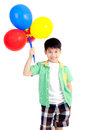 Happy asian cute boy with colorful balloons on white background Royalty Free Stock Photo