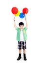 Happy asian cute boy with colorful balloons on white background Royalty Free Stock Photography