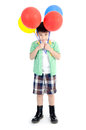 Happy asian cute boy with colorful balloons on white background Royalty Free Stock Photos