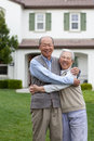 Happy Asian Elderly Couple in front Yard Stock Photo