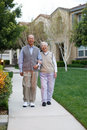 Happy Asian Elderly Couple in front Yard Royalty Free Stock Image