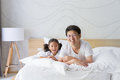 Happy asian family father and daughter smiling on bed Royalty Free Stock Photo