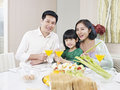 Happy asian family having meal at home Royalty Free Stock Image