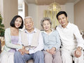 Happy asian family home portrait of a Stock Images