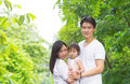Happy asian family outdoor portrait of parents and child having fun at garden park on weekend Stock Images