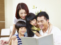 Happy asian family reading a book at home Royalty Free Stock Photo