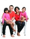 Happy asian family south east on white background red t shirt Stock Images