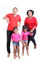 Happy asian family south east on white background red t shirt jumping Royalty Free Stock Photo