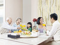 Happy asian family three generation having meal at home Stock Images