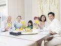 Happy asian family three generation having meal at home Stock Photography