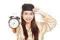 Happy Asian girl  wake up early morning show alarm clock Royalty Free Stock Photo