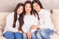 Happy asian girls and there mommy cheerful sitting home on sofa Royalty Free Stock Image