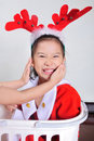 Happy asian little girl wearing christmas costume christmastime new year holiday concept Stock Images