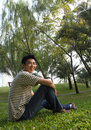 Happy asian man handsome young in the park Royalty Free Stock Images