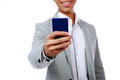 Happy asian man holding smartphone over white background focus on Royalty Free Stock Photography