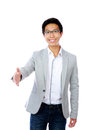 Happy asian man shake hand with you on white background Stock Photography