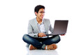 Happy asian man sitting on the floor Royalty Free Stock Photo