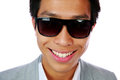 Happy asian man in sunglasses closeup portrait of a over white background Stock Photos