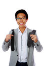 Happy asian man trying to choose a tie over white background Stock Photography