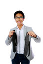 Happy asian man trying to choose a tie over white background Royalty Free Stock Photography