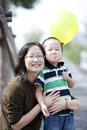 Happy asian mother and son Stock Images
