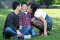 Happy asian parents kissing their son Royalty Free Stock Images