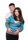 Happy asian pregnant couple isolated on white Royalty Free Stock Images