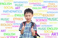 Happy Asian schoolboy wearing backpack and giving thumbs up Royalty Free Stock Photo