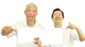 Happy Asian senior couple holding white blank sign ready for pro Royalty Free Stock Photo