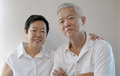 Happy asian senior couple white background love and hug on Royalty Free Stock Photography
