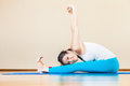 Happy asian woman doing exercise of yoga indoor at home and beautiful she looking camera and smiling you can maintain regular Royalty Free Stock Photos