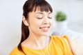 Happy asian woman with earphones listening music Royalty Free Stock Photo
