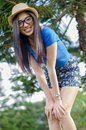 Happy Asians female in cowgirl hat and  wear glasses looking at Royalty Free Stock Photo