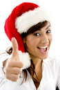 Happy attorney in christmas hat with thumbs up Royalty Free Stock Image