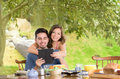 Happy attractive couple eats breakfast together a Royalty Free Stock Images