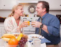 Happy Attractive Couple In Kitchen Stock Photography