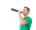 Happy attractive man with mouthpiece in green orator isolated on white Stock Images