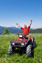 Happy ATV driver - quad Stock Images