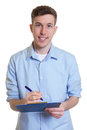 Happy australian businessman with clipboard writing note Royalty Free Stock Photo