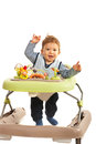 Happy baby in baby walker walking his home Royalty Free Stock Images