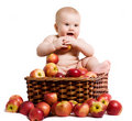 Happy baby in the basket with apples Stock Photos