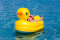 Happy baby in the boat little yellow duck Stock Photo