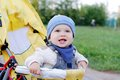 Happy baby boy age of months on baby carriage outdoors lovely Stock Image