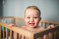 Happy Baby boy in his crib Royalty Free Stock Photo