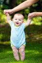 Happy baby boy learning to walk on grass Royalty Free Stock Photo